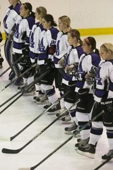 Stone stood, third from right, during introductions prior to a game against Cortland at the Orr Rink.